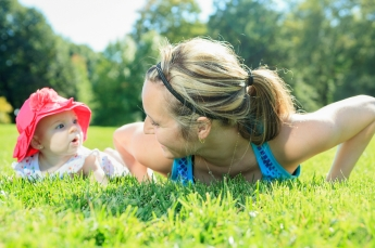 mother training with baby on a summer day